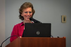 Sharon Frank speaking behind a lecturn